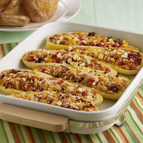Baked squash shells filled with the squash flesh, onion, tomatoes and bacon and finished with a cheesy crumb topping for a crowd-pleasing side dish