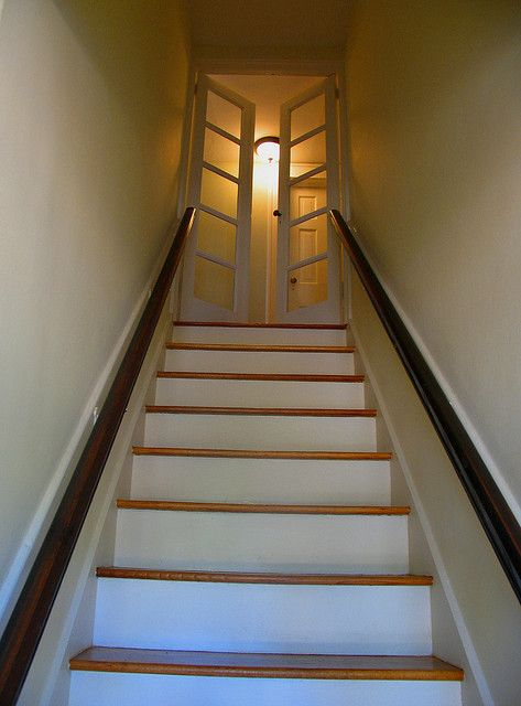 hmmm... french doors to basement? keeps small hallway airy.    French doors at top of stairs by byrdiegyrl, via Flickr