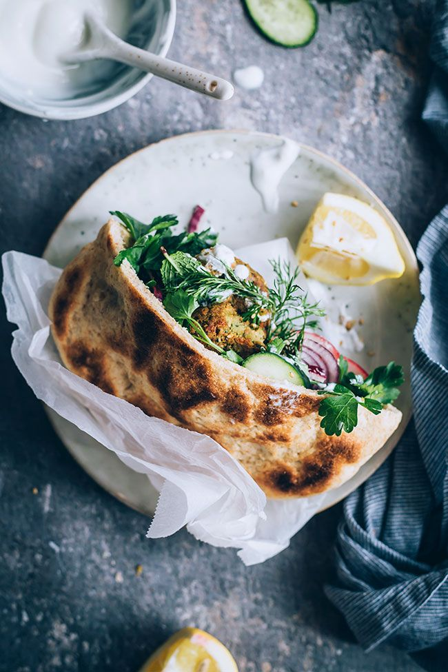 Falafel sandwich with pita bread and tahini sauce #vegetarian #lunch #sandwich #falafel | TheAwesomeGreen.com