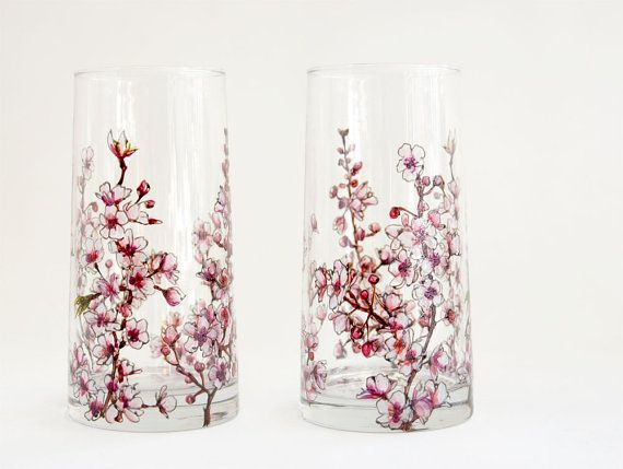 This set of 2 glasses dressed with cherry blossoms would be a stunning addition to your everyday dining ensemble, bringing you to smile and a touch of springtime to your table. On each glass, I lushly hand painted whispering pinks, masculine mahogany browns with an occasional grace of green leaves. I think the results are whimsically magical!  Dimensions: height 5 3/4 inches x diameter 2 3/4 inches. 16 oz. capacity  Up-cycled artwares are fired at high temperatures making them suita...
