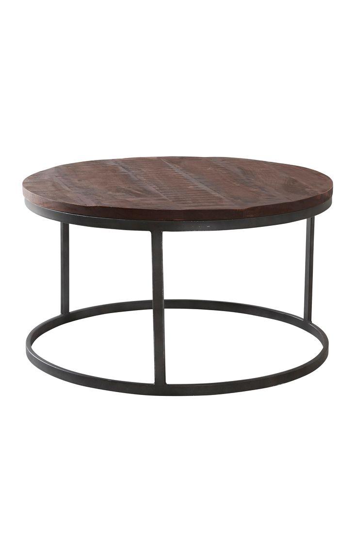 Rustikt stort bord i industriell stil. Grov bordsskiva i mangoträ som går i varma toner. Material: Trä och metall. Storlek: Höjd 43 cm, ø 76 cm. Beskrivning: Runt soffbord med bordsskiva i mangoträ och underrede av metall. Skötselråd: Torkas med fuktig trasa. Tips/råd: Matcha med fler produkter i den ruffa stilen, så som förvaringskorgen BRAEHUS.