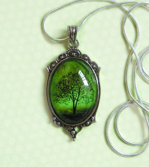 The last image is the original artwork of which this pendant features, Emerald Bewitched.    The pendant is attached to a silver plated snake chain