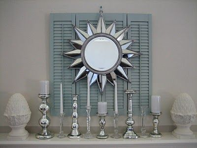 DIY Fireplace Mantel idea created with old shutters and a mirror from Michaels. Easy instructions.