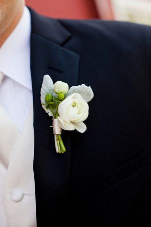 Ranunculus, hypericum berries, and dusty miller boutonniere