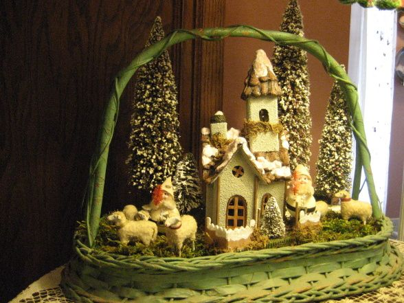 Snowy scenes in miniature, I've enjoyed putting these little scenes together with vintage, hand-crafted, and after-Christmas sale elements. , Another vintage basket tray, German Putz sheep, elves from my childhood Christmases, and an after-Christmas sale church from World Market. The moss is from our woods.    , Holidays Design