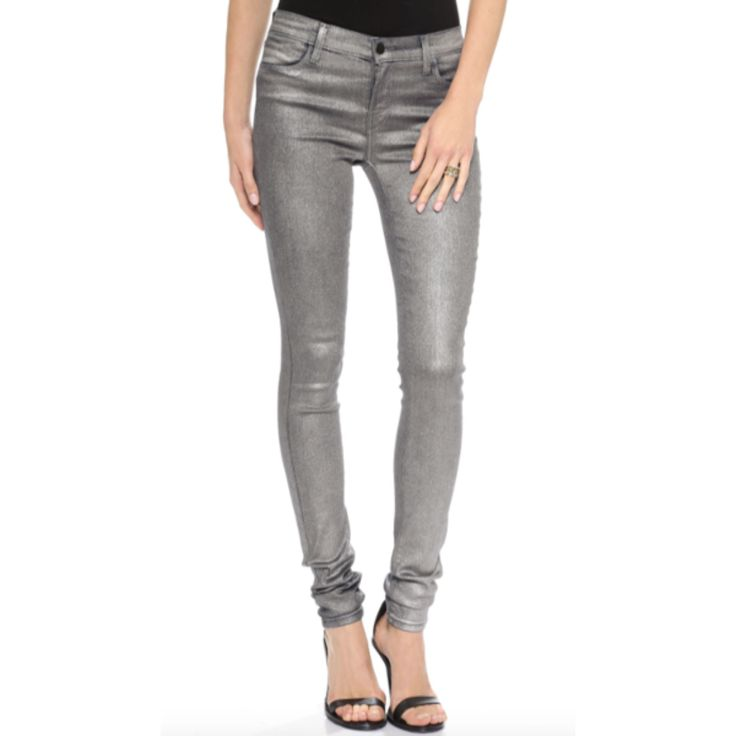 A metallic coating brings striking glamour to these 4-pocket J Brand skinny  jeans.