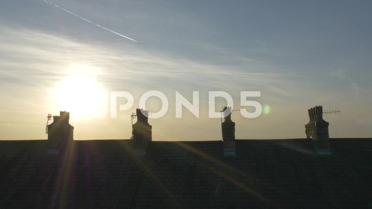 4k Sunset Time Lapse Behind Rooftop Chimneys Silhouette Planes Clouds Sun - Stock Footage | by RyanJonesFilms