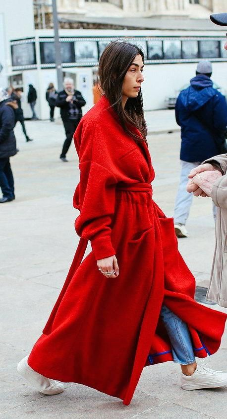Long red wool wrap coat, jeans, and white sneakers