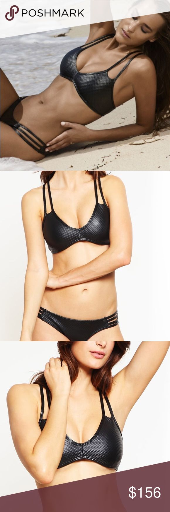 NWT PilyQ Posh Utopia Bikini in Textured Black This PilyQ Posh Utopia Halter Bikini is sexy and stylish!  This bikini has a pullover top that is cinched at the center bust.The bottoms have triple strap detail on the hips and come in a full cut. Cinched seam at the front Double neck straps Crisscross strap detail at back Pull over top (does not tie) No cups Available in full cut that offers full coverage in the back and covers bottom well Triple strap detail at hips Slight ruching at the top…