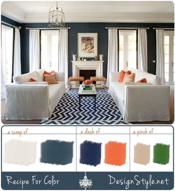 love the rug and orange accent pillows.