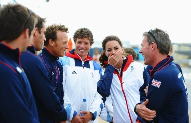 WEYMOUTH, ENGLAND - AUGUST 06:  Catherine, Duchess of Cambridge shares a joke with Finn class gold medal winner Ben Ainslie (2nd left) and Laser sailor Paul Goodison (3rd left) and other members of the Team GB sailing squad on Day 10 of the London 2012 Olympic Games at the Weymouth & Portland Venue at Weymouth Harbour on August 6, 2012 in Weymouth, England.