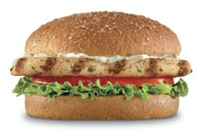 CHARBROILED ATLANTIC COD FISH SANDWICH - Only 400 Calories!   A charbroiled Atlantic Cod filet, tartar sauce, tomato and lettuce served on a honey wheat bun.