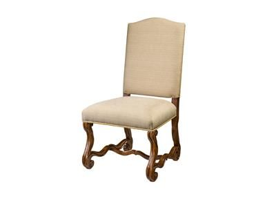 A hand carved mahogany side chair, the arched padded back and upholstered seat above scrolling hand carved legs joined by serpentine stretchers.