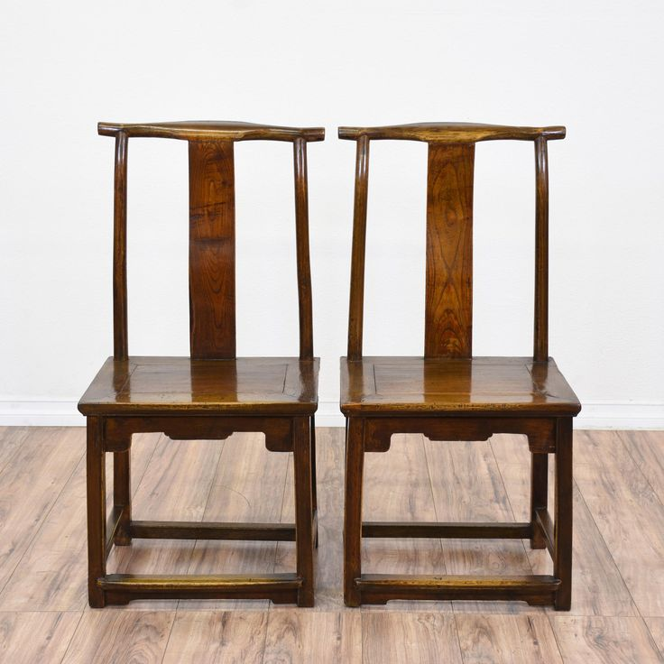 This pair of Asian-style side chairs is featured in a solid wood with a glossy rosewood finish. Each dining chair has box stretchers, Chinese characters etched into the splat, and carved apron. Perfect in any dining room! #asian #chairs #diningchair #sandiegovintage #vintagefurniture