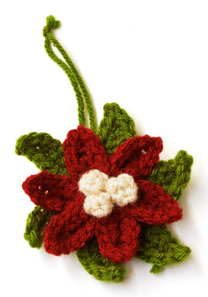 This easy Crochet Poinsettia Ornament is a wonderful small project to add to your collection of homemade Christmas ornaments. You will love the beauty and simplicity of this crochet flower pattern.