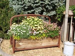 Old metal bed turned planter.