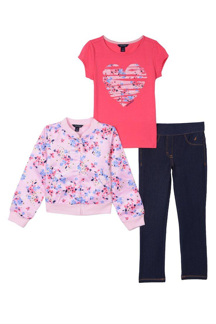 Nautica Little Girls' Satin Bomber Jacket, Knit Top and Jegging, Light Pink, 6X. Three Piece Set. Satin Bomber Jacket. Short Sleeve Top with Heart Artwork. Knit Denim Jegging.