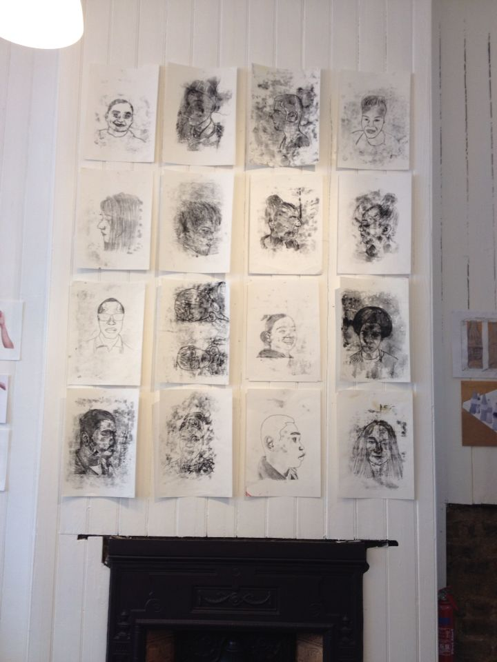 Wall of mono print portraits