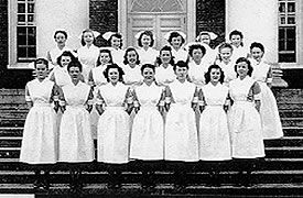 University of Virginia School of Nursing Class of February, 1948; The US Cadet Nurse Corps program condensed instructional time for nursing schools so they could graduate two classes per year instead of just one. The classes were staggered in admissions about six months apart, so the nine months of probationary period could be close to over with for one class before the following class began. This is the graduating class for February, 1948.