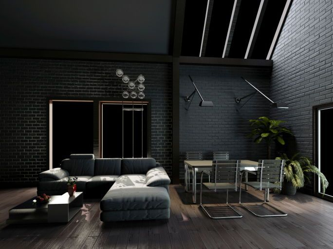 Dark living room with dark grey walls and sofa on dark