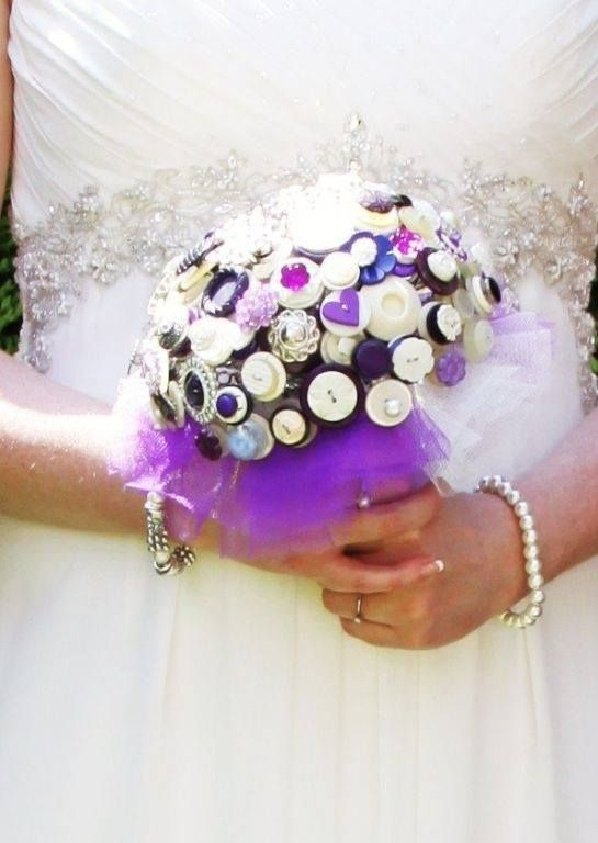 A close up of a most beautiful vintage bouquet - just look at the gorgeous detail on the dress and how the bouquet matches so perfectly