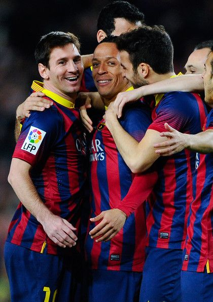 Adriano Correia (C) of FC Barcelona celebrates with his teammates after scoring the opening goal during the La Liga match between FC Barcelona and Rayo Vallecano de Madrid at Camp Nou on February 15, 2014 in Barcelona, Catalonia.