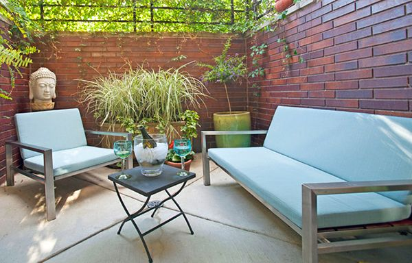 cozy outdoor space featuring stainless furniture by modernica outdoor stainless steel and bricks
