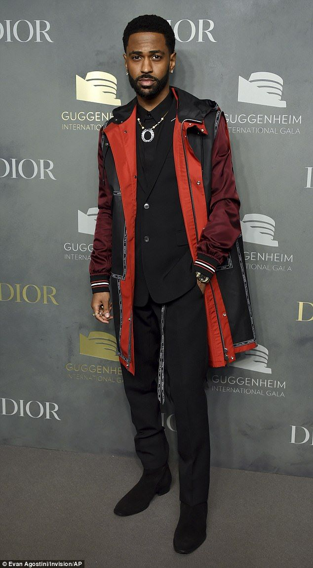 Rap style: Hip-hop star Big Sean paired a black suit with a multi-colored coat and a state...