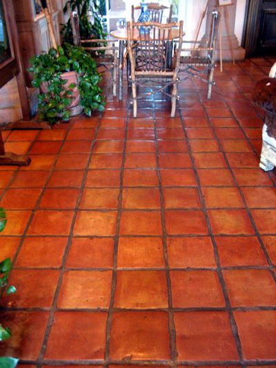 Mexican Saltillo Tile: I really like the warmth of this, I think with the colors we are interested in we could do this in the kitchen...yet, from here I think I feel your hesitancy! ha!