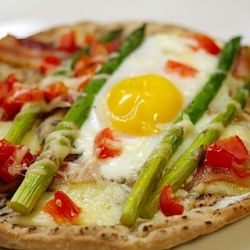This pita pizza topped with an egg makes the perfect breakfast, lunch, or dinner!
