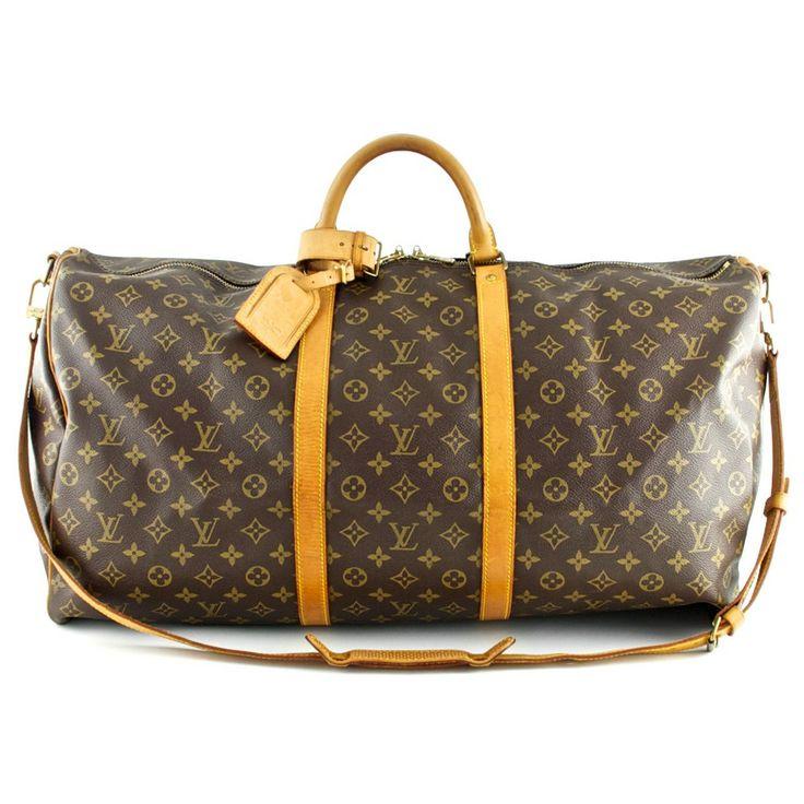 Authentic Louis Vuitton Monogram Canvas Keepall 60 Bag with strap at THEBROWNPAPERBAG.NET #authentic #vintage #parisian #luxury #louisvuitton