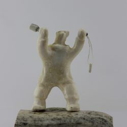 Shaman Bear by Louie Makkituq is a phenomenal carving in cream stone. A striking piece.