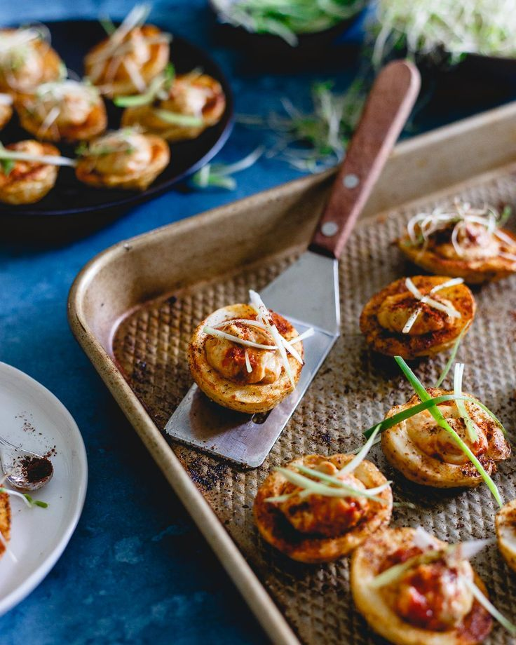Celebrate National Hummus Day with these hummus stuffed potato cups. Full of smoky spice flavor and the perfect little roasted bite for a slightly out of the box appetizer or side dish. | @sabra #sponsored