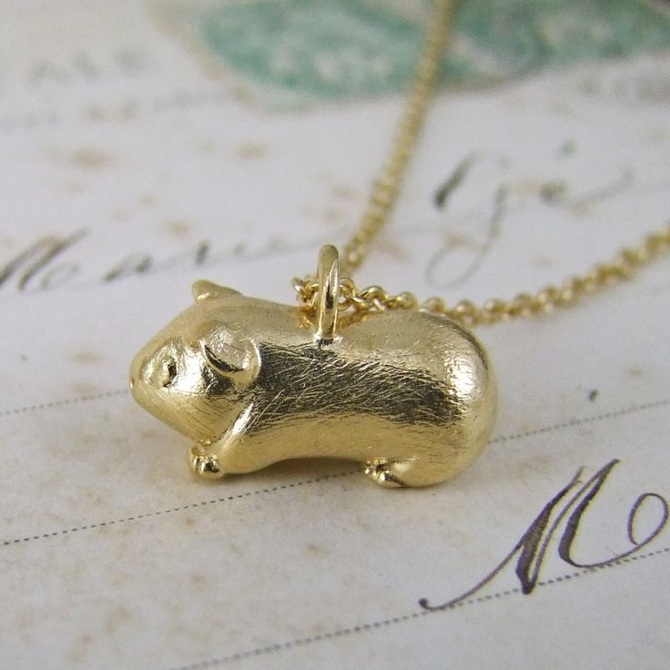 A cute solid silver Guinea pig pendant by Alexis Dove, inspired by our favorite pets