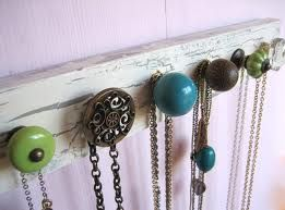 Old piece of wood with cute, miscellaneous knobs attached=Awesome necklace hanger!