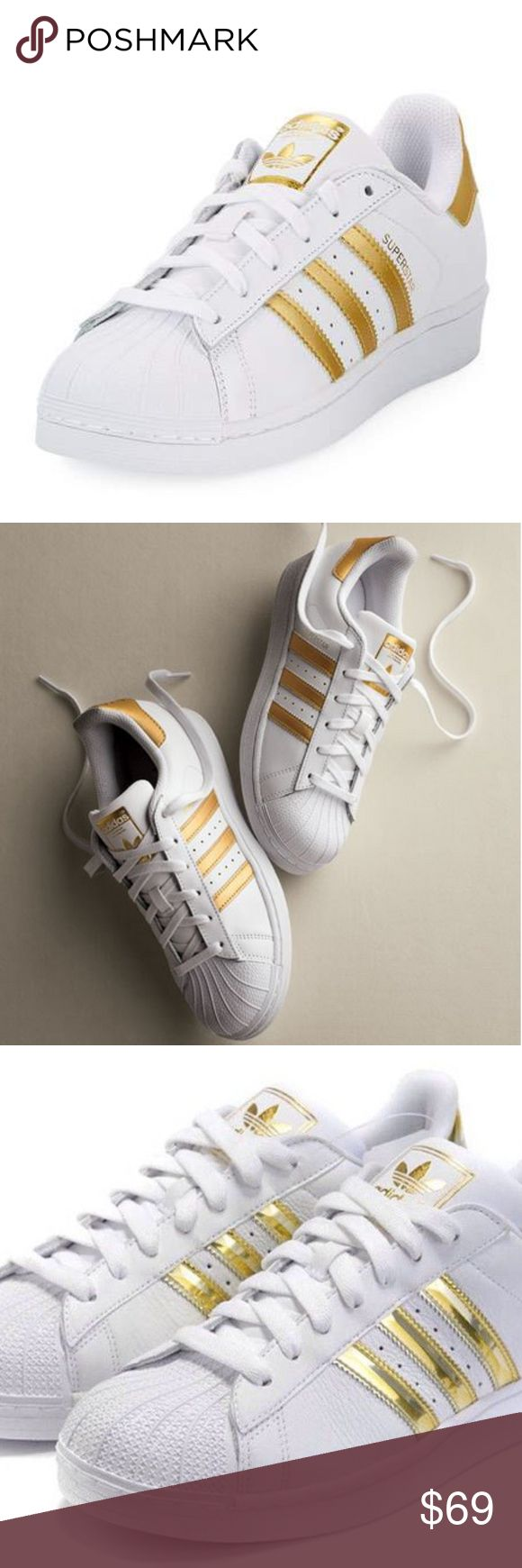 ADIDAS Superstar Original Fashion Sneakers NIB! In White/Gold   *Classic sneakers with three stripes and foil print *Leather and rubber upper *Shell toe *Lace-up vamp *Metallic heel patch *Rubber sole  ❌NO TRADES  I❤️Bundles ❤️REASONABLE OFFERS ONLY PLEASE❤️ adidas Shoes Sneakers
