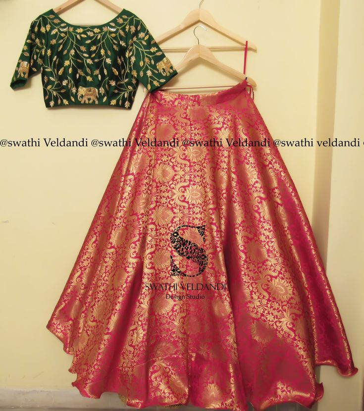 Beautiful pink color benaras skirt and green color crop top with floret lata and elephant design hand embroidery gold thread work. Call / watsapp : +918179668098 for details..colors and size can be customized 28 February 2018