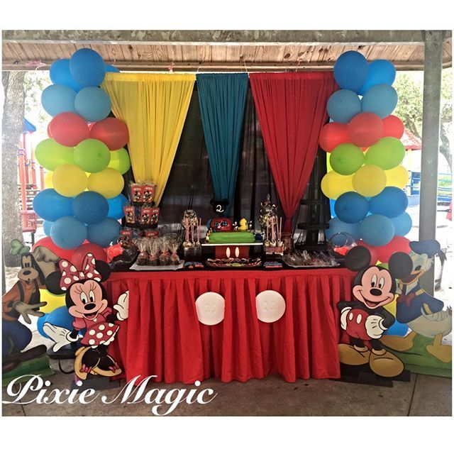 Mickey Mouse Club House cake table #mickeymouseclubhouse #mickeymouseclubhouseparty #mickeymouseclubhouse #mickeymouse #pixiemagic #caketable #woodcutouts #backdrop #omghownice #candytable #ballooncolumns