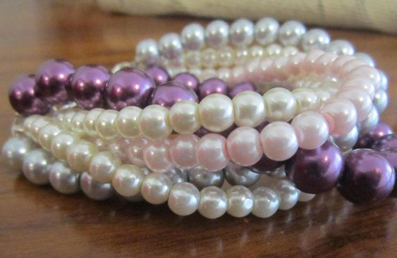 A chunky, pearl bracelet featuring five beaded strands of ivory, blush pink, gray and plum glass pearls that are twisted and braided into this stunning design - by SLDesignsHBJ #pearl #wedding #bracelet #jewelryonetsy