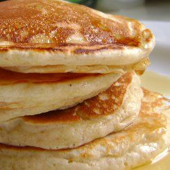 South African Buttermilk Pancakes 1 cup cake flour 1/2 teaspoon sugar 1/2 teaspoon salt 1 teaspoon bicarbonate of soda 3/4 teaspoon baking powder 1 egg 2 teaspoons melted butter 250ml buttermilk Butter for frying