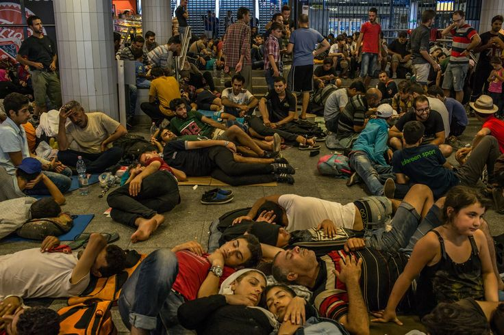 ozens of families, mostly from Syria, rested underneath the Keleti train station in Budapest.: