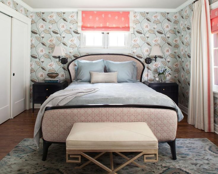 This bedroom's not huge, but the oversized floral pattern wallpaper and coral-colored shades give it tons of stylish energy. An elegant bench and upholstered bed frame are welcome, subtler companions.