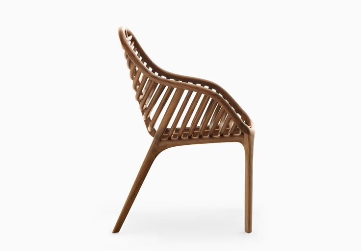 A Bionic Chair Design by STUDIOFORMA, Zurich. PAM is a wooden tubular chair design that is shaped to mimic the structure of a palm leaf.