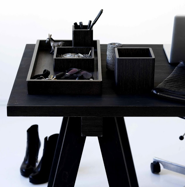 black desk with all black office supplies