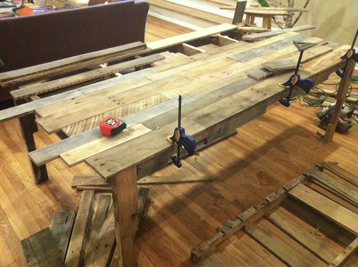 Daniel made this dining table entirely from carefully disassembled shipping pallets and finished it with a mixture of coconut oil and locally-harvested beeswax. It's his masterpiece, and I am as gi...