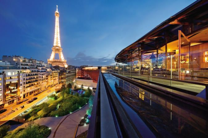 Seine River Cruise and Rooftop Dinner at Les Ombres Restaurant with Eiffel Tower Views On this memorable evening in Paris, enjoy a scenic Seine River cruise followed by a rooftop dinner at Les Ombres Restaurant.  As you cruise down the Seine River, admire the sights of Paris and learn about the history of Paris from the informative audio guide. Following your cruise, relax at Les Ombres Restaurant, located on the rooftop of the Musée du Quai Branly, and enjoy an authenti...