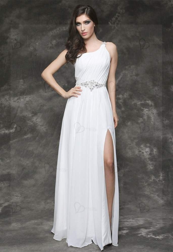 http://www.chouchourouge.com/robe-de-soiree-longue-fendue-en-mousseline.html  Longue robe de soirée en mousseline fine de couleur immaculée blanche munie d'une bretelle unique et dévoilant avec sensualité une épaule. Le buste de la robe légèrement plissé est maintenu par cette bretelle unique qui est décorée par une belle broche de cristaux semi-précieux ces mêmes cristaux qui se retrouvent au niveau de la taille sous la forme d'une magnifique ceinture scintillante et irrésistiblement…
