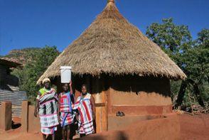 Local community family outside Venda hut