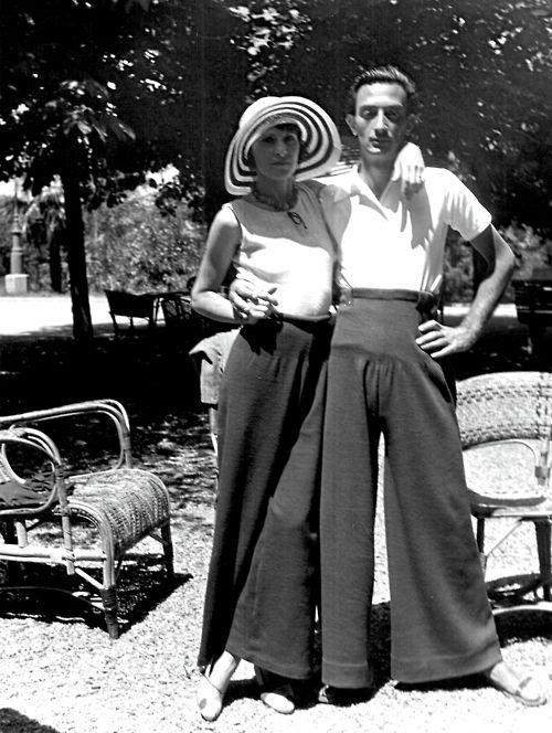 Gala Dalí (September 7, 1894 – June 10, 1982) & Salvador in giant pants (of the 30s?). hat