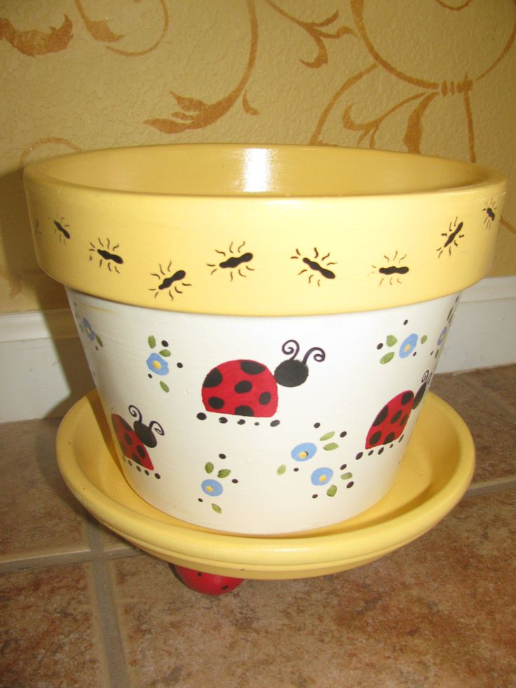 painting flower pots | Pot is painted in yellows and creams with ladybugs and flowers all the ...